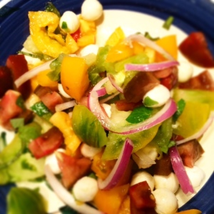 Heirloom tomato salad with red onion and mozzarella