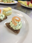 Smoked salmon tea sandwich (front), Gougere with goat cheese and pear filling (back).